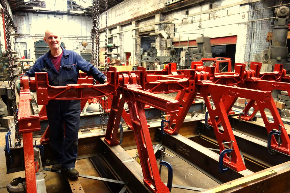 Colin fits the headstocks into the reconstructed bell frame.