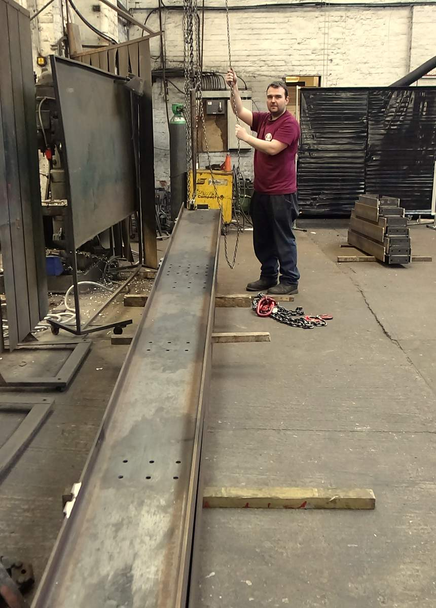 Anthony begins laying out the base girders for the bell frame.