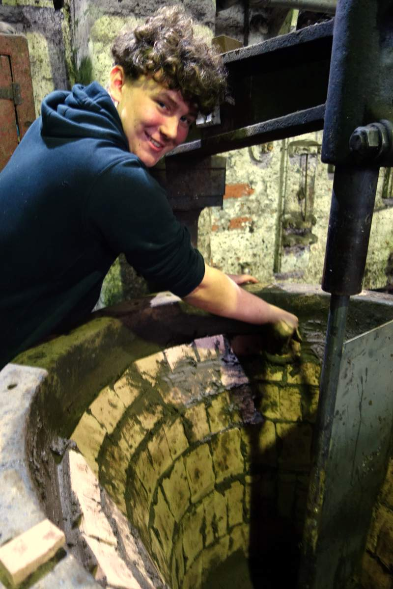Apprentice Sam prepares one of the moulds.