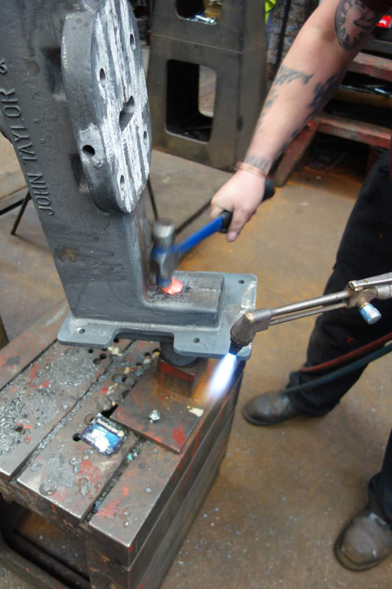 Bill forge welds gudgeons on a new headstock.