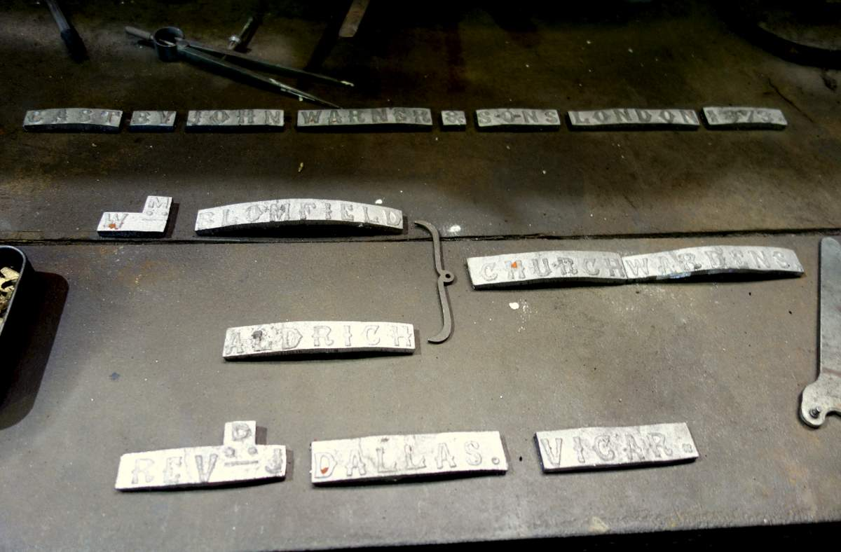 Lead facsimile castings of one of the original Laxfield bells for reproducing on the new bell.